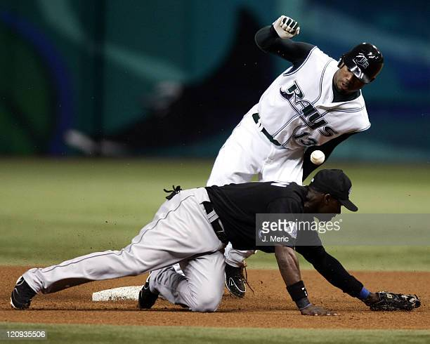 Tampa Bay Devil Rays outfielder Carl Crawford slides safely into second with a stolen base as Toronto Blue Jays infielder Orlando Hudson tries to...