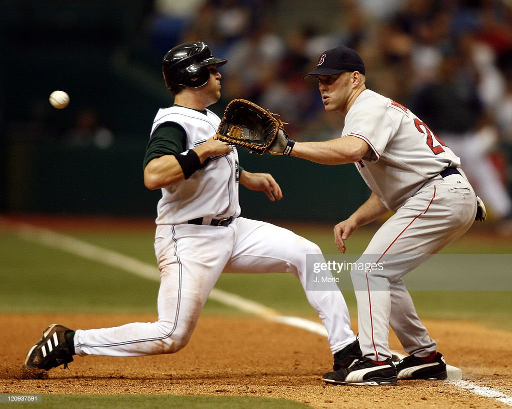 Tampa Bay infielder Sean Burroughs gets back to first as Boston's Kevin Youkilis takes the throw at Tropicana Field, St. Petersburg, Florida, April 30, 2006. Tampa Bay defeated Boston 5-4.