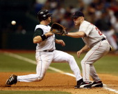 Tampa Bay infielder Sean Burroughs gets back to first as Boston's Kevin Youkilis takes the throw at Tropicana Field St Petersburg Florida April 30...