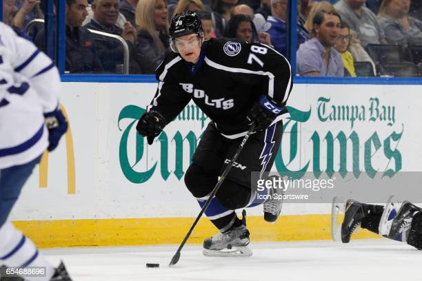 Tampa Bay Lightning center Byron Froese skates with the puck in the 1st period of the NHL game between the Toronto Maple Leafs and Tampa Bay...