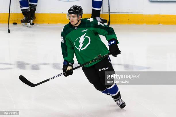 Tampa Bay Lightning center Byron Froese wears a green Saint Patricks Day sweater as he skates during pregame warm ups before the NHL game between the...
