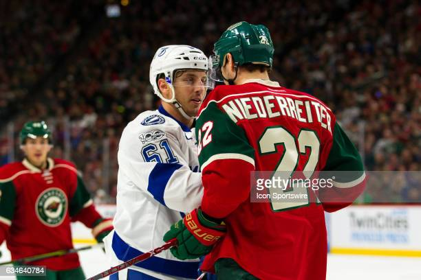 Tampa Bay Lightning center Gabriel Dumont and Minnesota Wild right wing Nino Niederreiter shove each other in the 3rd period during the regular...