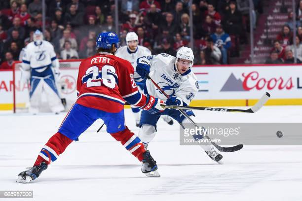 Tampa Bay Lightning Center Greg McKegg shooting the puck into Canadiens territory in front of Montreal Canadiens Defenceman Jeff Petry during the...