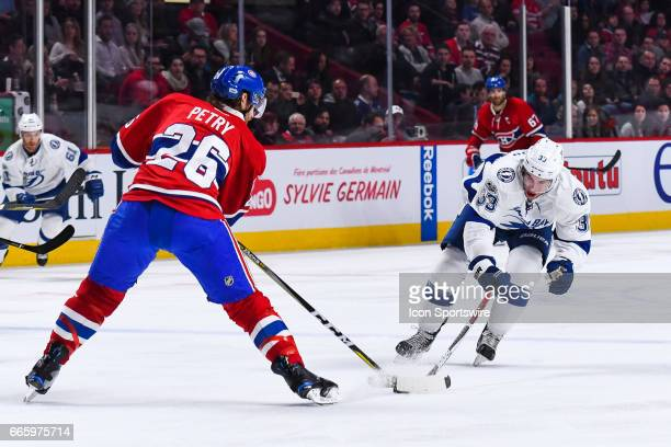 Tampa Bay Lightning Center Greg McKegg stretching to reach the puck controlled by Montreal Canadiens Defenceman Jeff Petry during the Tampa Bay...