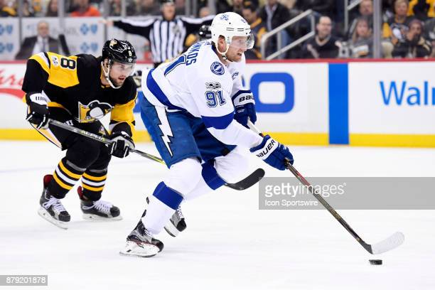 Tampa Bay Lightning Center Steven Stamkos skates with the puck as Pittsburgh Penguins Defenseman Brian Dumoulin chases during the first period in the...