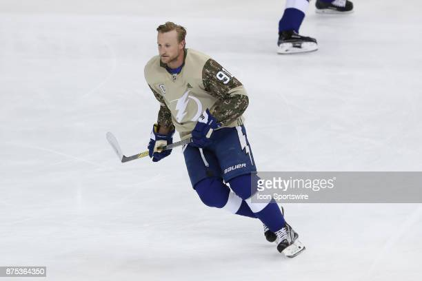 Tampa Bay Lightning center Steven Stamkos wears a military appreciation jersey as he skates during warm ups before the NHL game between the Dallas...