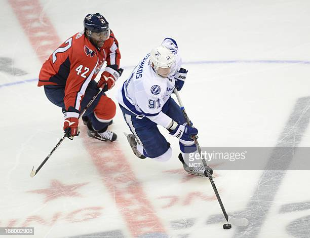 Tampa Bay Lightning center Steven Stamkos works the puck across center ice ahead of Washington Capitals right wing Joel Ward in the third period at...