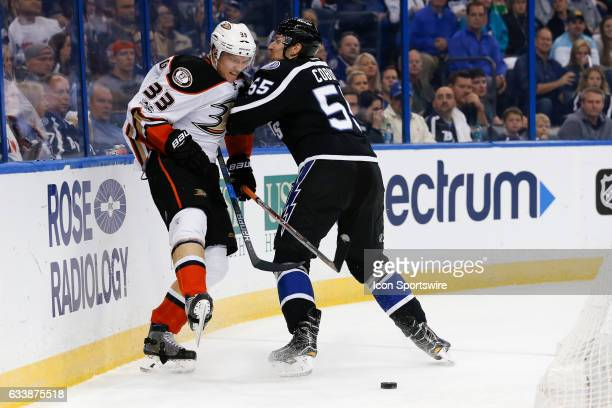 Tampa Bay Lightning Defenceman Braydon Coburn checks Anaheim Ducks right wing Jakob Silfverberg in the second period of the NHL game between the...
