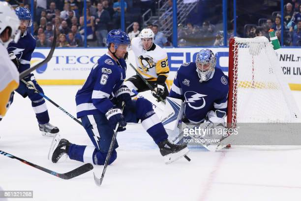 Tampa Bay Lightning defenseman Anton Stralman blocks the pass to Pittsburgh Penguins center Sidney Crosby with his foot in front of Tampa Bay...
