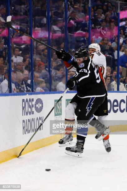 Tampa Bay Lightning defenseman Jake Dotchin checks Anaheim Ducks center Ryan Getzlaf behind the Lightning net in the second period of the NHL game...