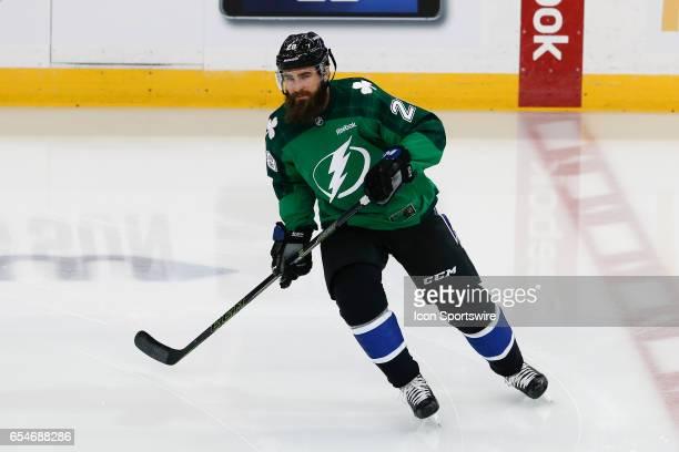 Tampa Bay Lightning defenseman Luke Witkowski wears a green Saint Patricks Day sweater as he skates during pregame warm ups before the NHL game...