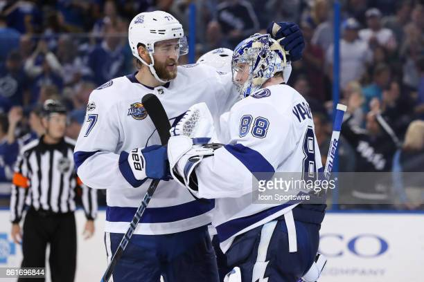 Tampa Bay Lightning defenseman Victor Hedman and Tampa Bay Lightning goalie Andrei Vasilevskiy celebrate after the NHL game between the St Louis...