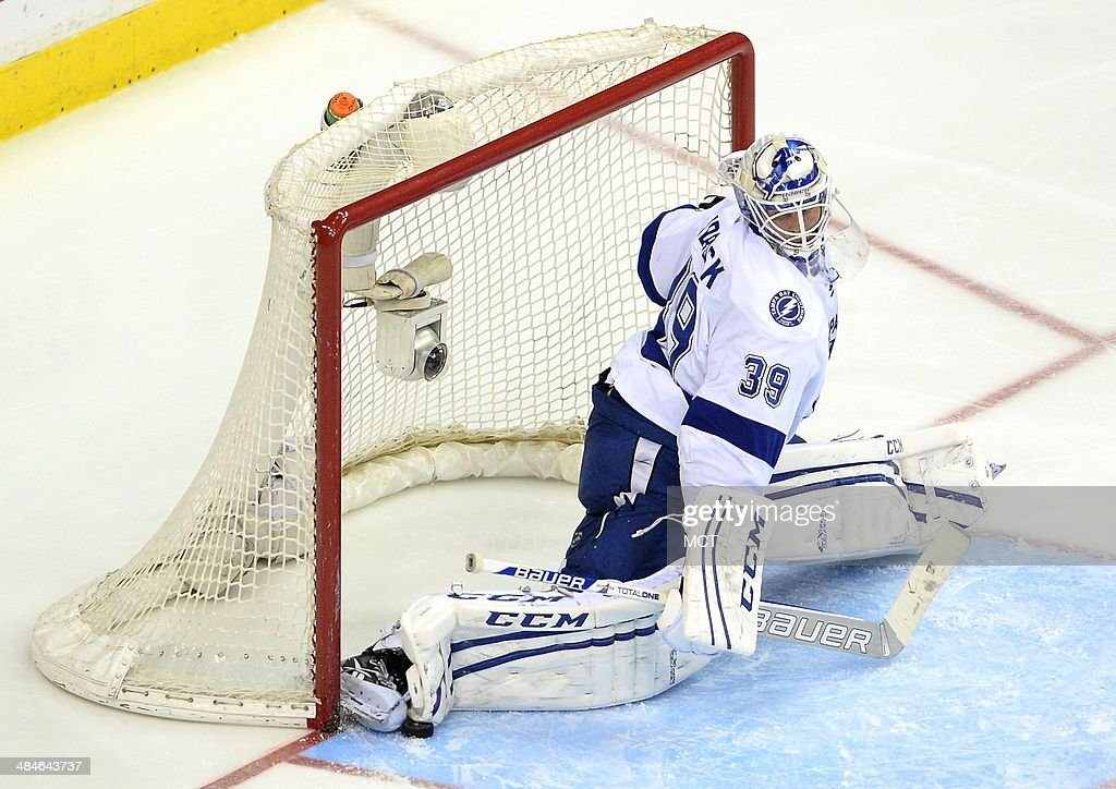 Tampa Bay Lightning goalie Anders Lindback (39) makes a save against the Washington Capitals in the third period at the Verizon Center in Washington, Sunday, April 13, 2014. The Lightning defeated the Capitals in a shootout, 1-0.