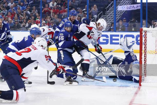 Tampa Bay Lightning goalie Andrei Vasilevskiy dives to make a save after Washington Capitals center Evgeny Kuznetsov tries to kick the puck into the...