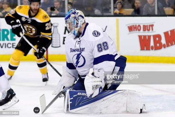 Tampa Bay Lightning goalie Andrei Vasilevskiy knocks a shot down during a regular season NHL game between the Boston Bruins and the Tampa Bay...