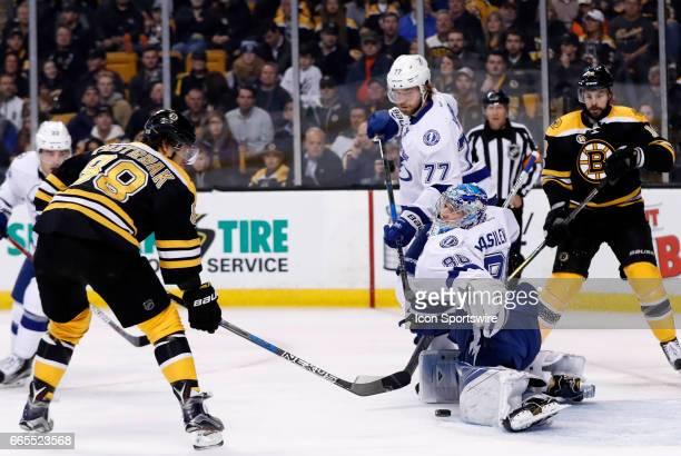 Tampa Bay Lightning goalie Andrei Vasilevskiy makes a left pad save on Boston Bruins right wing David Pastrnak during a regular season NHL game...