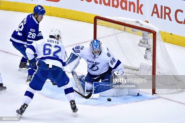 Tampa Bay Lightning Goalie Andrei Vasilevskiy makes a pad save in front of Tampa Bay Lightning Defenceman Andrej Sustr during the regular season NHL...