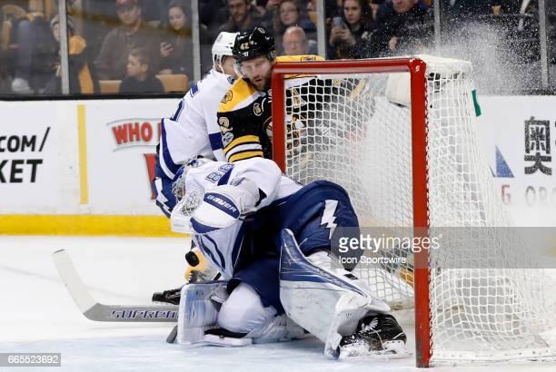 Tampa Bay Lightning goalie Andrei Vasilevskiy makes the stop on Boston Bruins center David Backes during a regular season NHL game between the Boston...