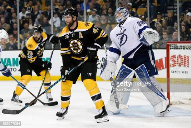 Tampa Bay Lightning goalie Andrei Vasilevskiy peeks over Boston Bruins center David Backes during a regular season NHL game between the Boston Bruins...