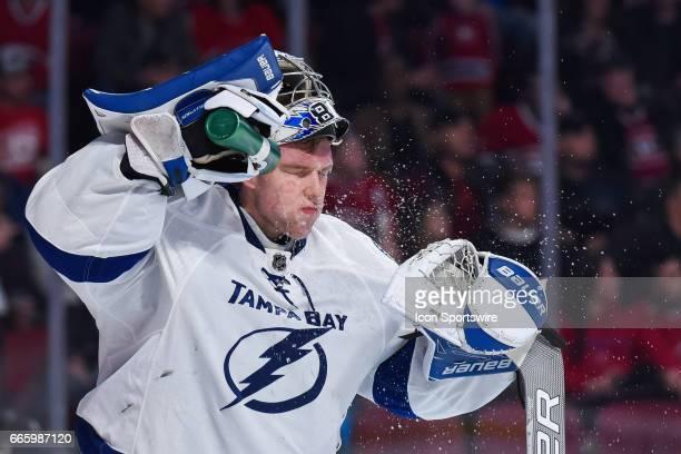 Tampa Bay Lightning Goalie Andrei Vasilevskiy spraying water on his face in between plays during the Tampa Bay Lightning versus the Montreal...
