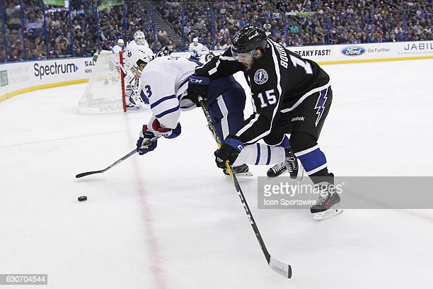 Tampa Bay Lightning left wing Michael Bournival checks Toronto Maple Leafs center Nazem Kadri to the ice battling for the puck in the first period of...