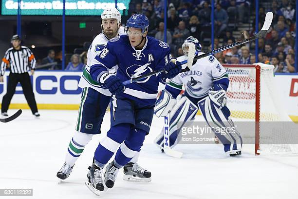 Tampa Bay Lightning left wing Ondrej Palat and Vancouver Canucks defenseman Erik Gudbranson in action during the first period of the NHL game between...