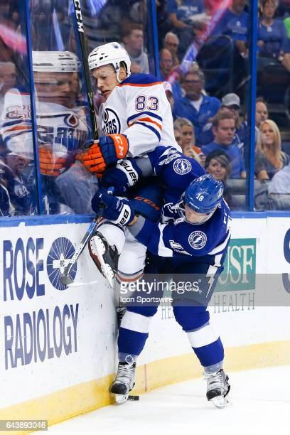 Tampa Bay Lightning left wing Ondrej Palat checks Edmonton Oilers defenseman Matt Benning into the glass behind the Edmonton Oilers net in the first...
