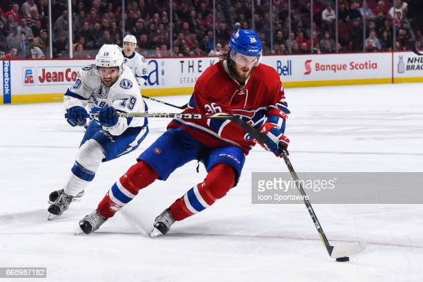 Tampa Bay Lightning Right Wing Cory Conacher chasing Montreal Canadiens Defenceman Brett Lernout who is in control of the puck during the Tampa Bay...