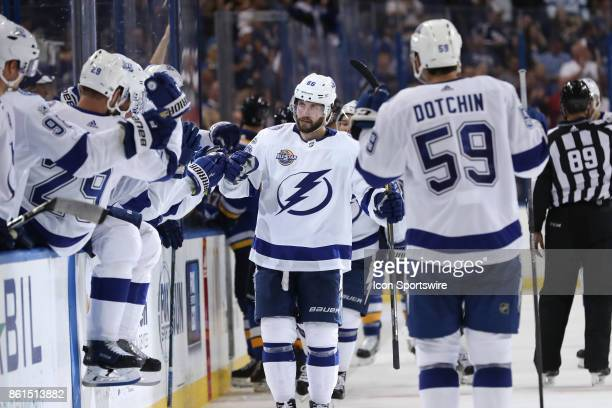 Tampa Bay Lightning right wing Nikita Kucherov is congratulated by teammates on the bench after scoring a goal in the 3rd period of the NHL game...