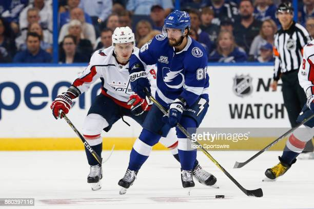Tampa Bay Lightning right wing Nikita Kucherov is defended by Washington Capitals defenseman Dmitry Orlov during the NHL game between the Washington...