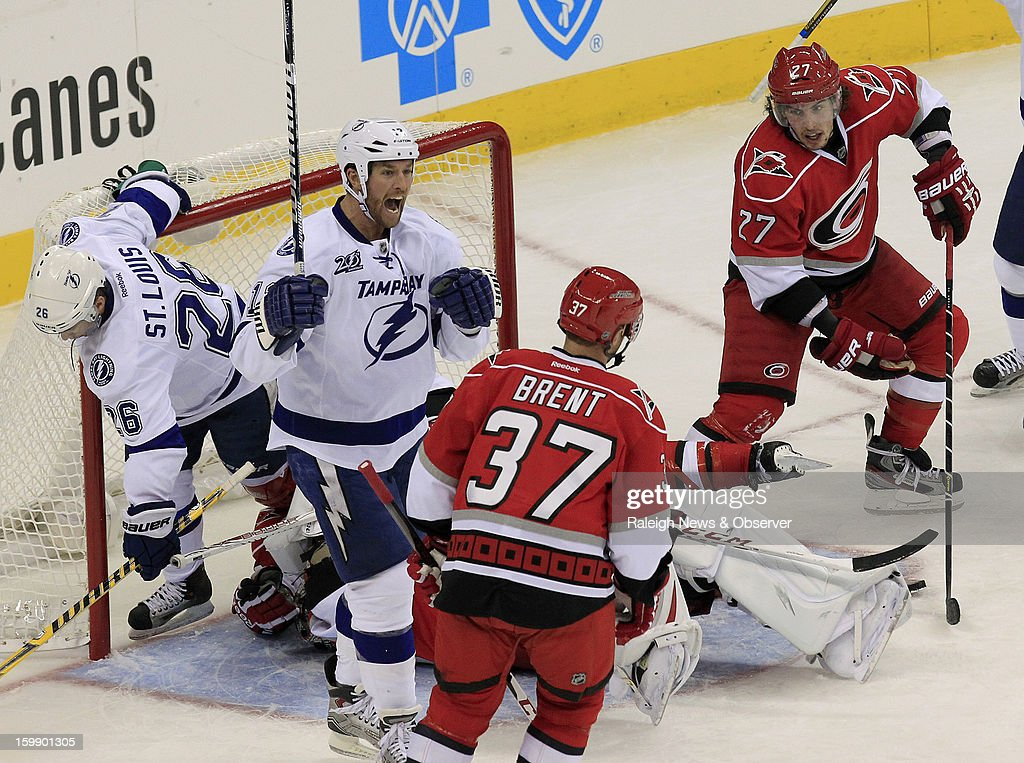 Tampa Bay Lightning's Ryan Malone (12) celebrates his goal against Carolina Hurricanes' Cam Ward (30) at PNC Arena in Raleigh, North Carolina, Tuesday, January 22, 2013. The Lightning defeated the Hurricanes, 4-1.