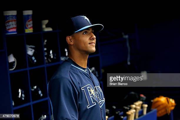 Tampa Bay Rays 2015 firstround draft selection outfielder Garrett Whitley looks out from the dugout before taking batting practice for the first time...