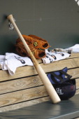 A Tampa Bay Rays bat and helmet in the dug out during a baseball game against the Baltimore Orioles on June 29 2014 at Oriole Park at Camden Yards in...