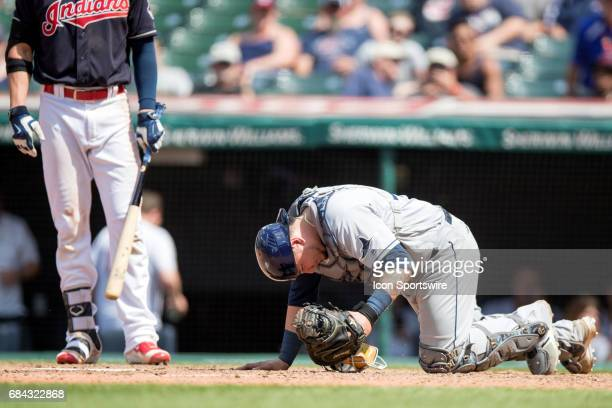 Tampa Bay Rays Catcher Jesus Sucre is shaken up after being hit by a foul tip during the ninth inning of the Major League Baseball game between the...