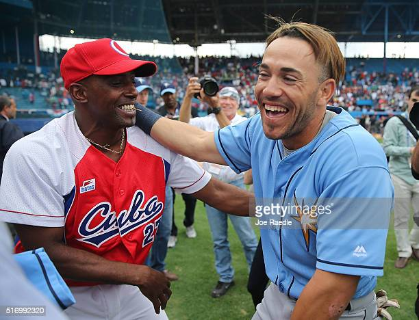 Tampa Bay Rays Dayron Varona who defected from Cuba in 2013 is hugged by members of the Cuban National team after an exposition game at the Estado...
