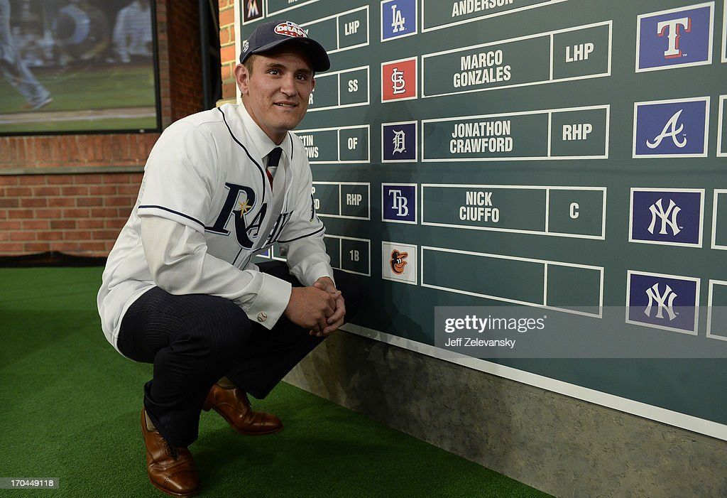 Tampa Bay Rays draftee Nick Ciuffo poses near the draft board at the 2013 MLB First-Year Player Draft at the MLB Network on June 6, 2013 in Secaucus, New Jersey.