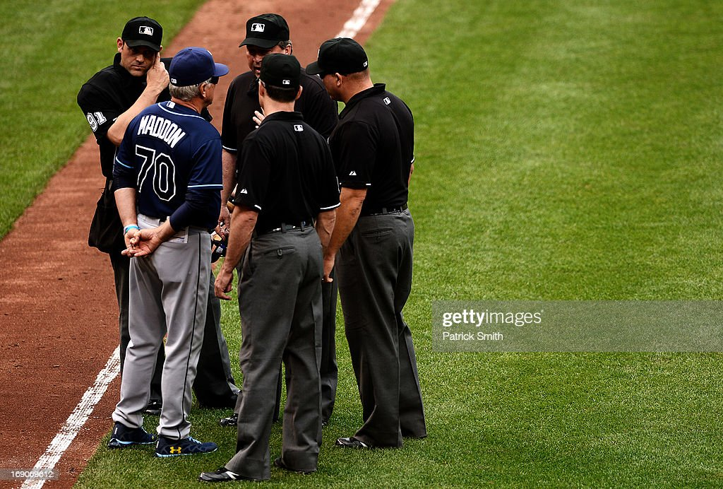 Tampa Bay Rays manager <a gi-track='captionPersonalityLinkClicked' href=/galleries/search?phrase=Joe+Maddon&family=editorial&specificpeople=568433 ng-click='$event.stopPropagation()'>Joe Maddon</a> argues a call with the umpires after a Matt Joyce #20 of the Tampa Bay Rays (not pictured) hit was not ruled a homerun, but then over turned, in the sixth inning against the Baltimore Orioles at Oriole Park at Camden Yards on May 19, 2013 in Baltimore, Maryland. The Tampa Bay Rays won, 3-1.