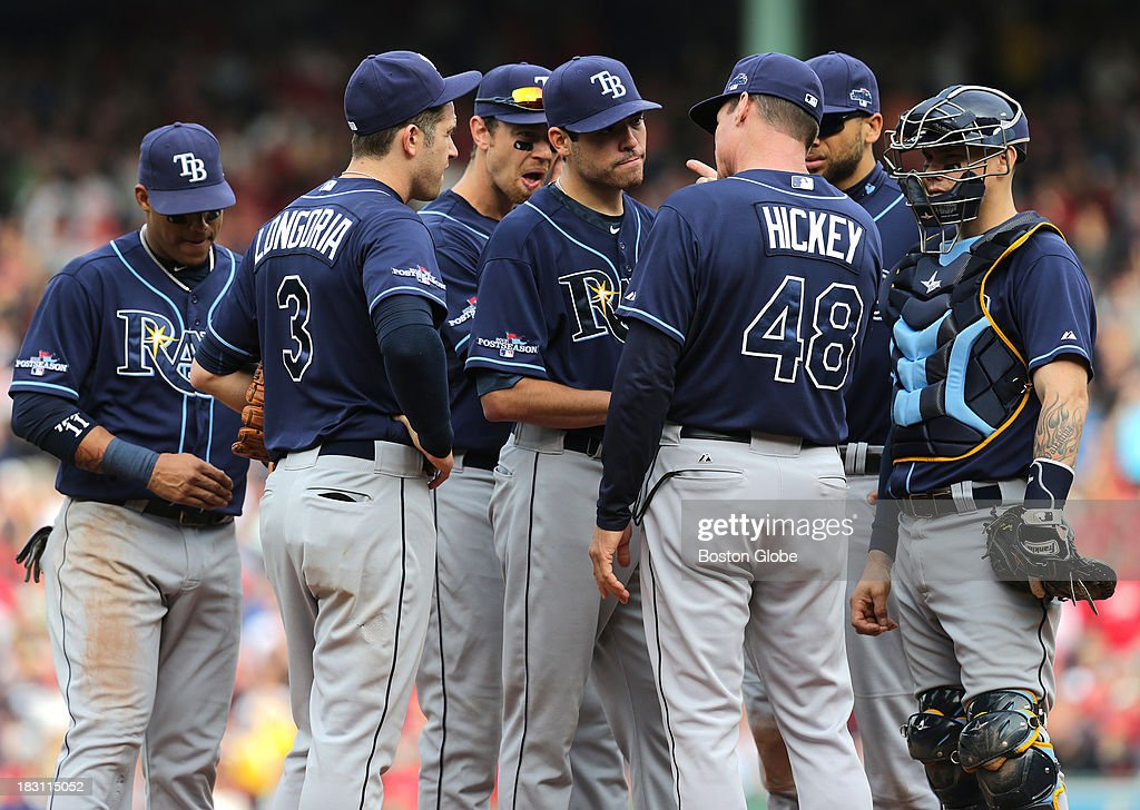 Tampa Bay Rays pitching coach Jim Hickey (#48) talks to Tampa Bay Rays starting pitcher Matt Moore (#55) during a 5-run Red Sox fourth inning. The Boston Red Sox take on the Tampa Bay Rays in Game One of the ALDS at Fenway Park.