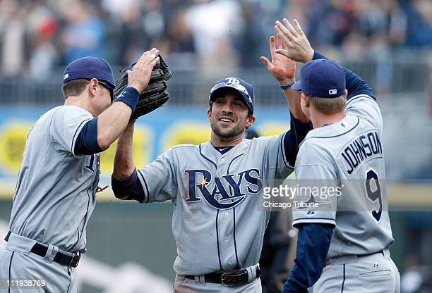 Tampa Bay Rays right fielder Sam Fuld middle is congratulated by teammates after making a diving catch on a fly out by Chicago White Sox' Juan Pierre...