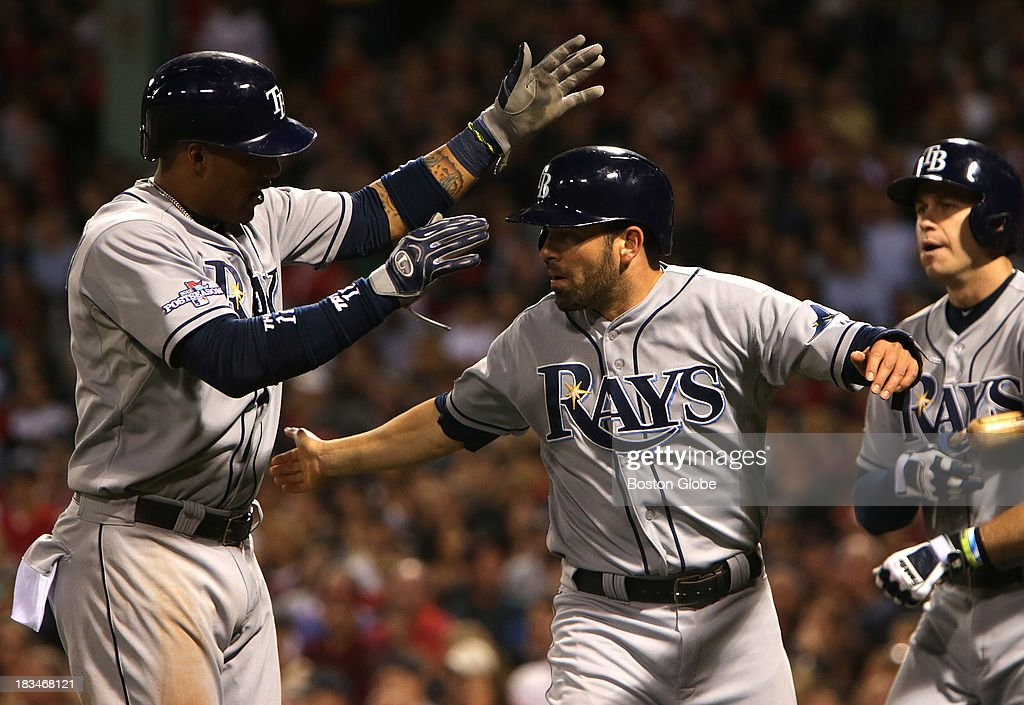 Tampa Bay Rays shortstop Yunel Escobar (#11) and Tampa Bay Rays left fielder David DeJesus (#7) celebrate after scoring in the fifth inning. The Boston Red Sox take on the Tampa Bay Rays in Game Two of the ALDS at Fenway Park.