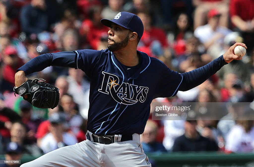 Tampa Bay Rays starting pitcher <a gi-track='captionPersonalityLinkClicked' href=/galleries/search?phrase=David+Price+-+Baseball+Player&family=editorial&specificpeople=4961936 ng-click='$event.stopPropagation()'>David Price</a> (#14) engaged in a pitcher's duel with Boston Red Sox starting pitcher <a gi-track='captionPersonalityLinkClicked' href=/galleries/search?phrase=Jon+Lester&family=editorial&specificpeople=832746 ng-click='$event.stopPropagation()'>Jon Lester</a> (#31) as the Boston Red Sox hosted the Tampa Bay Rays at Fenway Park.