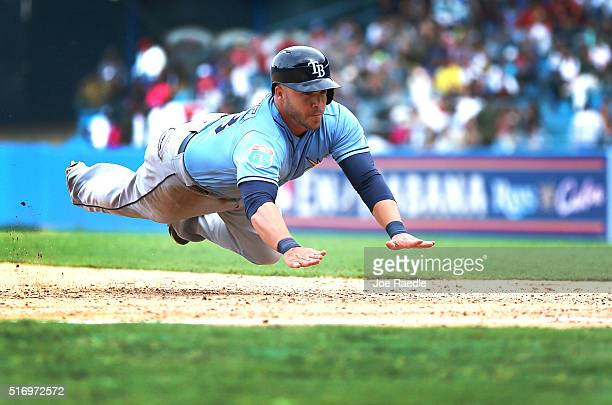 Tampa Bay Rays Steve Pearce dives safely into third base during the exhibition game between the Cuban national team and the Tampa Bay Rays of the...
