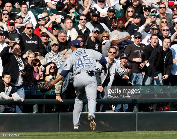 Tampa Bay Rays third baseman Felipe Lopez tries to catch a foul ball hit by Chicago White Sox' AJ Pierzynski during the fourth inning at US Cellular...
