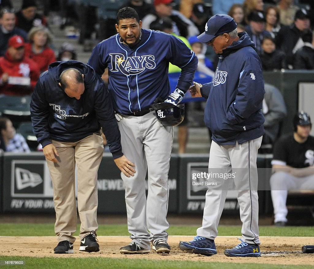 Tampa Bay Rays trainer Ron Porterfield looks at <a gi-track='captionPersonalityLinkClicked' href=/galleries/search?phrase=Jose+Molina&family=editorial&specificpeople=206365 ng-click='$event.stopPropagation()'>Jose Molina</a>'s #28 knee as <a gi-track='captionPersonalityLinkClicked' href=/galleries/search?phrase=Joe+Maddon&family=editorial&specificpeople=568433 ng-click='$event.stopPropagation()'>Joe Maddon</a> #70 looks during the fourth inning in a game against the Chicago White Sox on April 27, 2013 at U.S. Cellular Field in Chicago, Illinois.