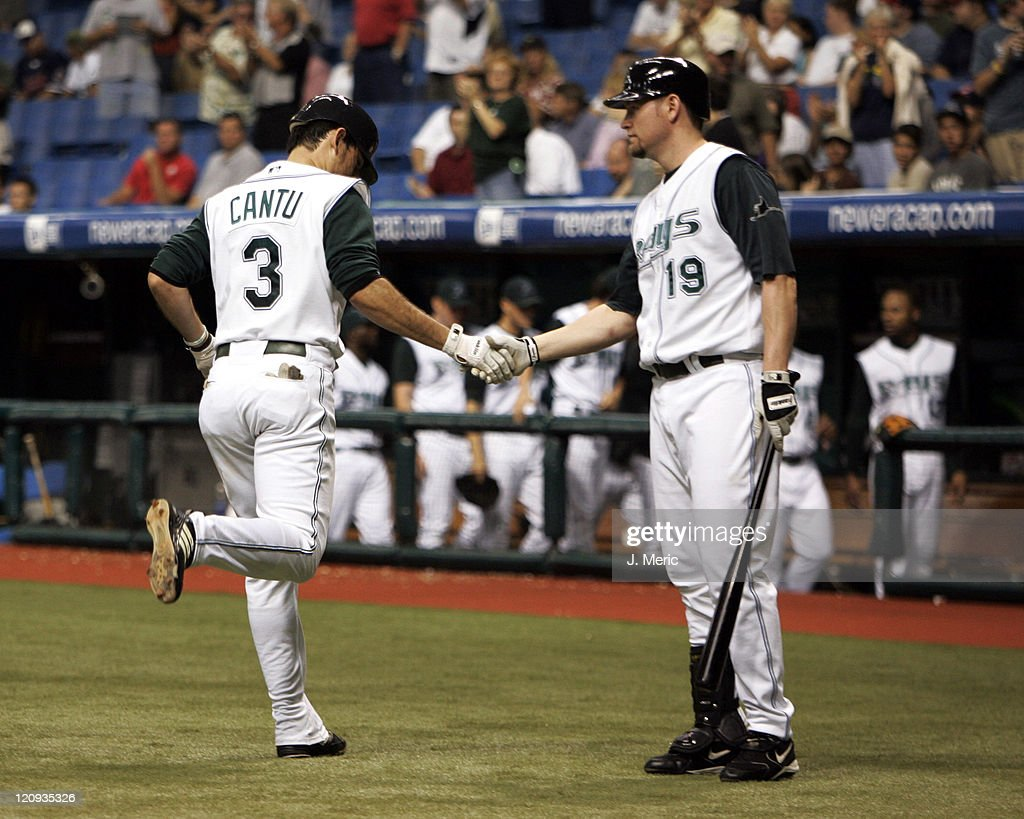 Tampa Bay's Jorge Cantu is congratulated by <a gi-track='captionPersonalityLinkClicked' href=/galleries/search?phrase=Aubrey+Huff&family=editorial&specificpeople=208964 ng-click='$event.stopPropagation()'>Aubrey Huff</a> after his homer in Monday night's game against the Cleveland Indians at Tropicana Field in St. Petersburg, Florida on August 22, 2005.