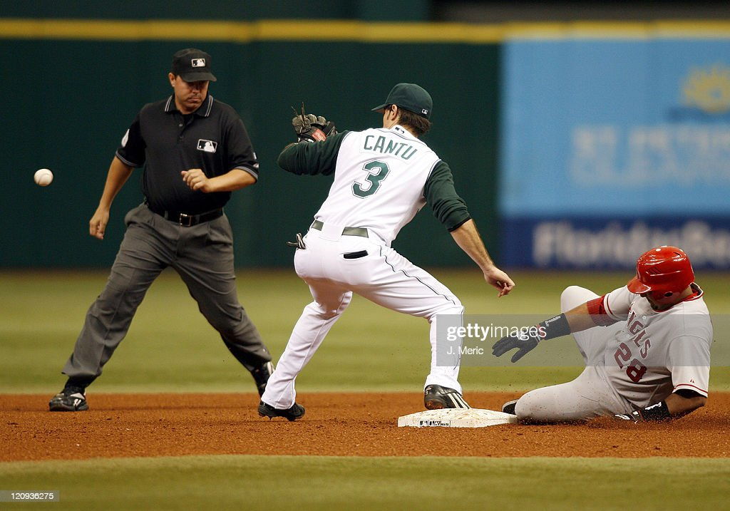 Tampa Bay's Jorge Cantu prepares for the throw as Los Angeles catcher Jose Molina slides safely into second during Wednesday's action at Tropicana Field in St. Petersburg, Florida on July 26, 2006.