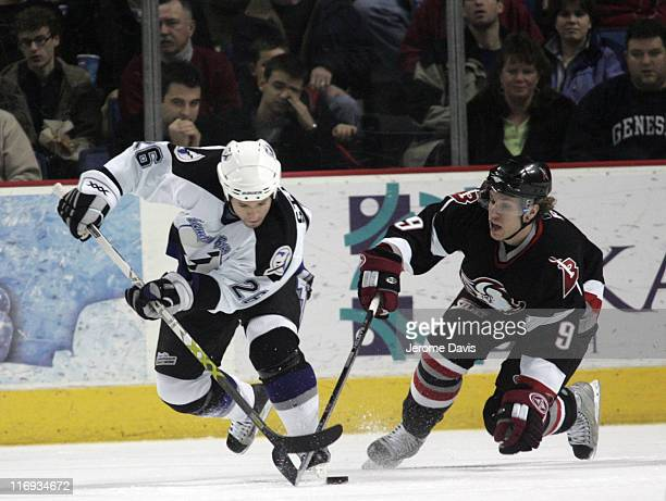 Tampa Bay's Martin St Louis tries to skate away from Sabres' Derek Roy during a game at the HSBC Arena in Buffalo New York January 5 2006 Buffalo...