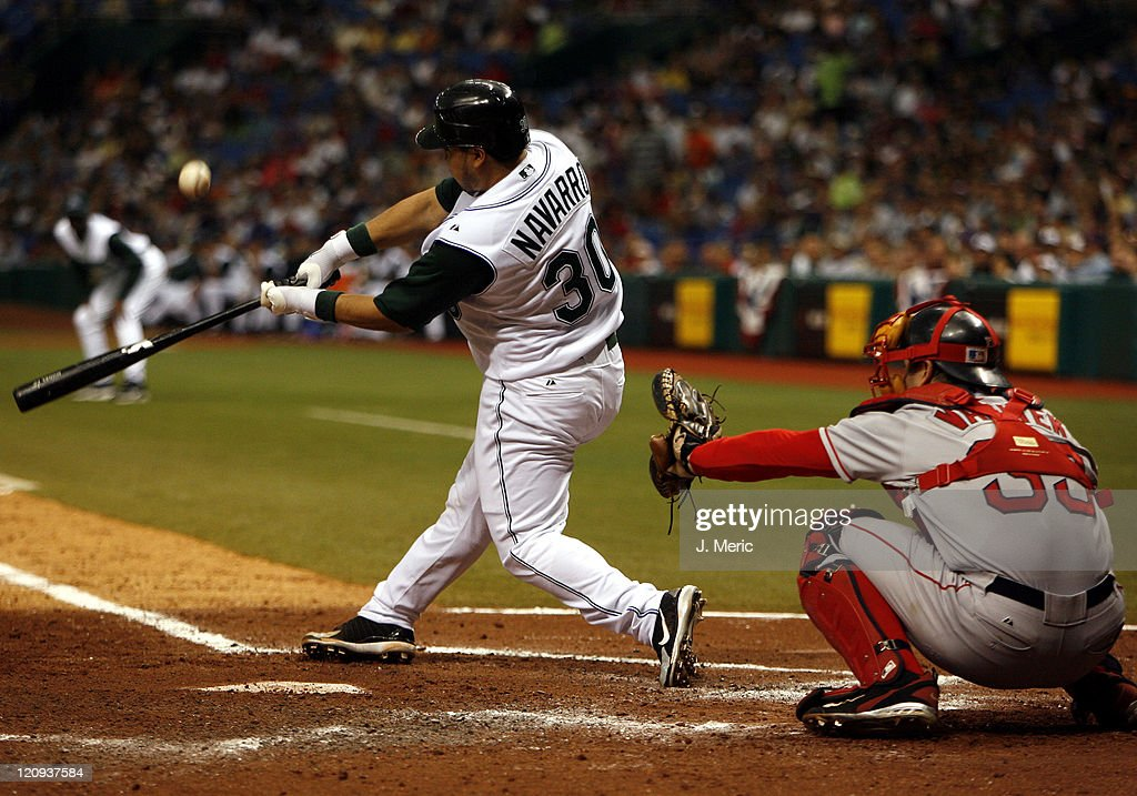 Tampa Bay's newly acquired catcher <a gi-track='captionPersonalityLinkClicked' href=/galleries/search?phrase=Dioner+Navarro&family=editorial&specificpeople=593062 ng-click='$event.stopPropagation()'>Dioner Navarro</a> fouls off this pitch as Boston's <a gi-track='captionPersonalityLinkClicked' href=/galleries/search?phrase=Jason+Varitek&family=editorial&specificpeople=171480 ng-click='$event.stopPropagation()'>Jason Varitek</a> prepares to receive this pitch during Tuesday's game at Tropicana Field in St. Petersburg, Florida on July 4, 2006.
