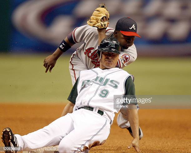 Tampa Bay's Tomas Perez slides safely into third as Atlanta's Wilson Betemit was late with the tag in Friday night's action at Tropicana Field in St...