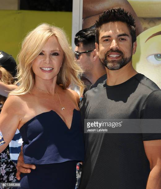 Tamra Judge and husband Eddie Judge attend the premiere of 'The Emoji Movie' at Regency Village Theatre on July 23 2017 in Westwood California